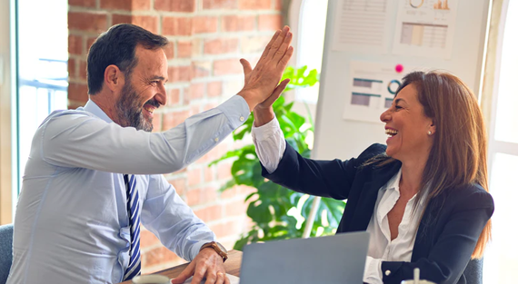 marketing professionals high fiving each other